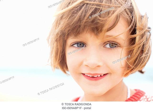 Close up of smiling child looking into distance