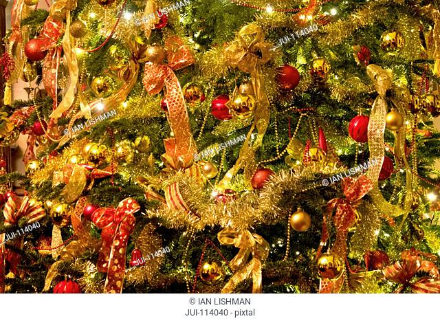 Full frame close up Christmas tree with ornaments and bow decorations