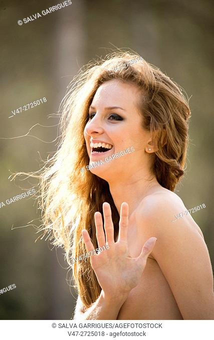 topless young woman laughing and looking at camera, Alboy, Genoves, Valencia, Spain, Europe