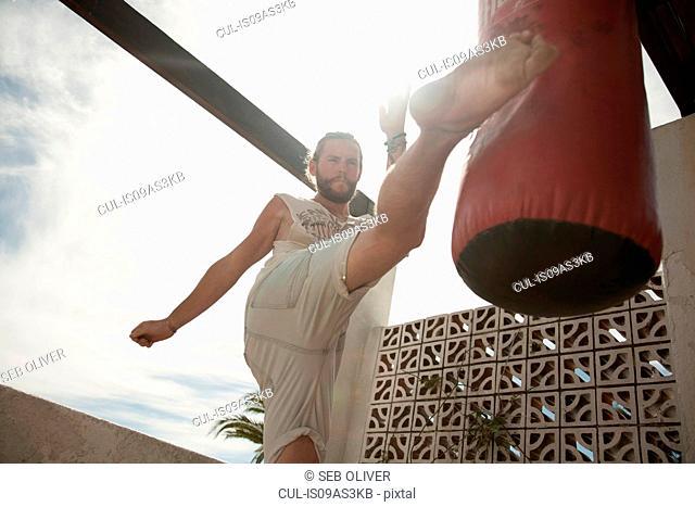 Man practising kickboxing