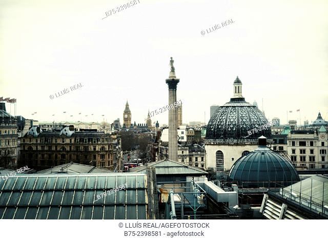 Dome of the National Gallery and Nelson's column in Trafalgar Square, Big Ben and Houses of Parliament, view from a window of Portrait Gallery in the center of...