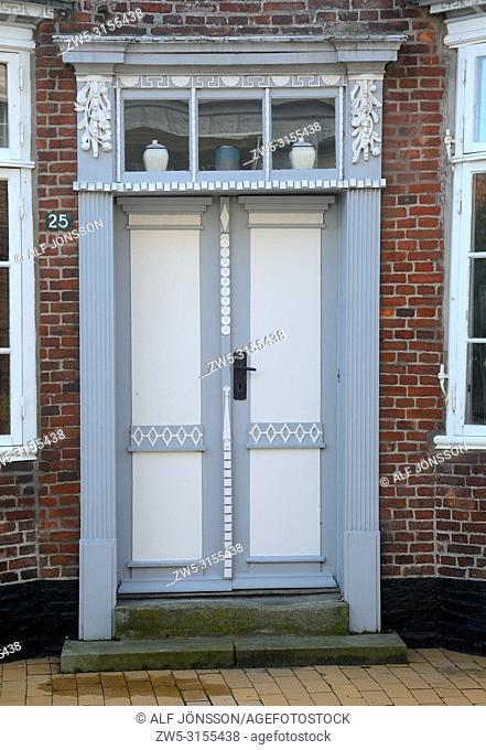 Old wooden decorative front door in the medieval city of Tønder, Slesvig; Jutland, Denmark