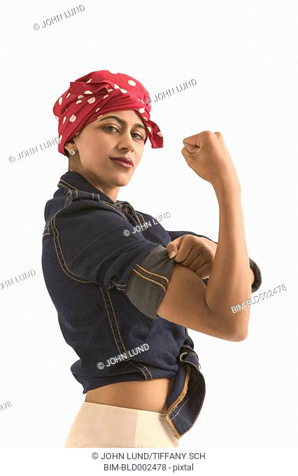Young woman dressed as Rosie the Riveter