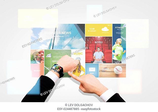 business, people, media and modern technology concept - close up of businessman pointing to smart watch at his hand with news application