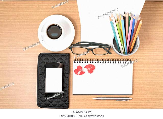 office desk: coffee with phone, wallet, calendar, color pencil box, notepad, heart on wood background vintage style