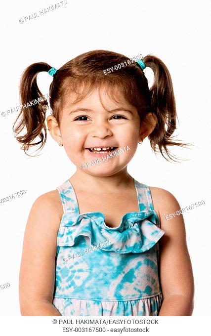 Beautiful expressive adorable happy cute laughing smiling young toddler girl with ponytails showing teeth, isolated