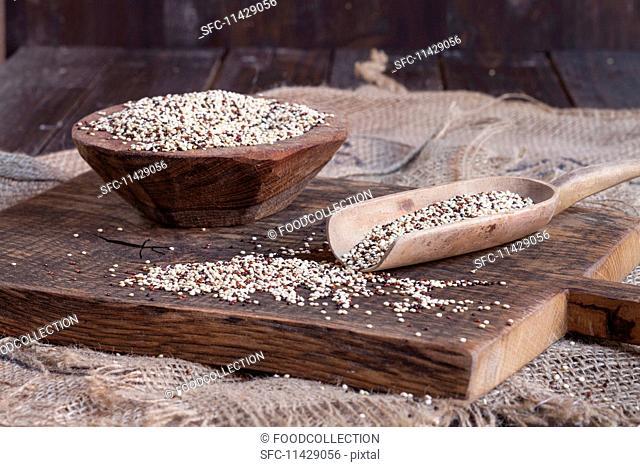 Tricoloured quinoa on a wooden board