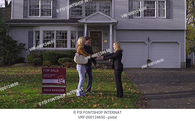 MS, TU, couple meeting a real estate agent to look at a house for sale