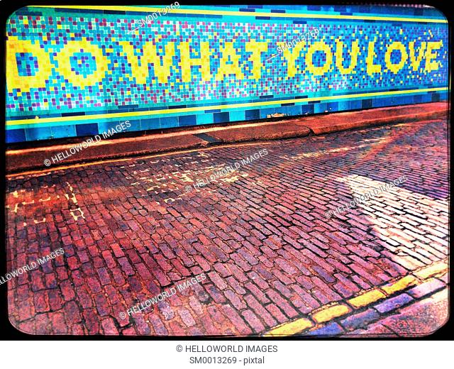 'Do what you love' on tiled wall, London, England Europe