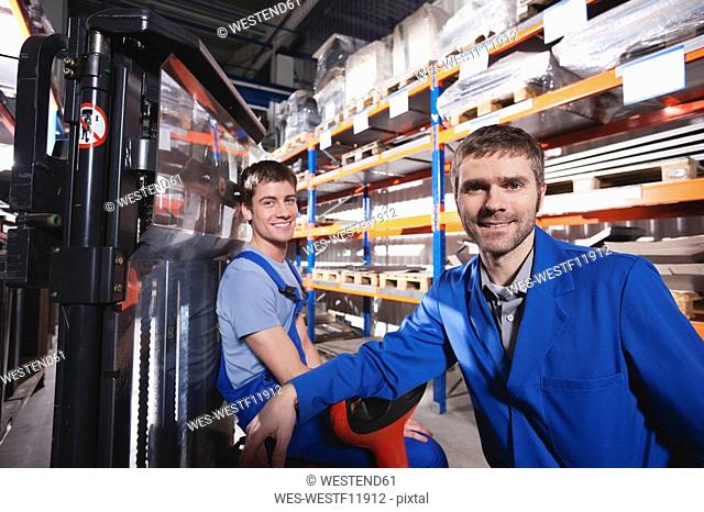 Germany, Neukirch, Apprentice and foreman in storeroom
