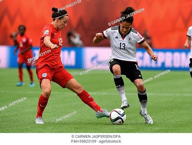 Germany's Celia Sasic (R) and Lucy Bronze from England vie for the ball during the FIFA Women's World Cup 2015 third place soccer match between England and...