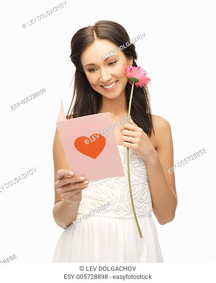 picture of young woman holding flower and postcard