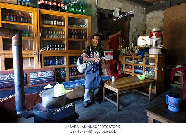 Local man in a general store, Trongsa Town, Bhutan, Asia