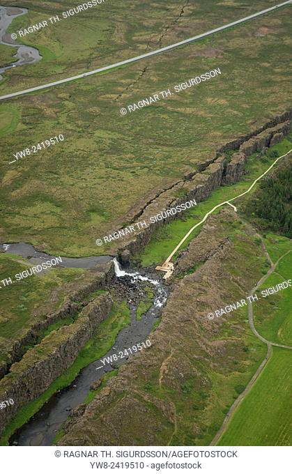 Mid-Atlantic Ridge, Almannagja Fissure, Thingvellir National Park, Iceland. The cracks and faults of the Alamannagja fissure is where the Eurasian and North...