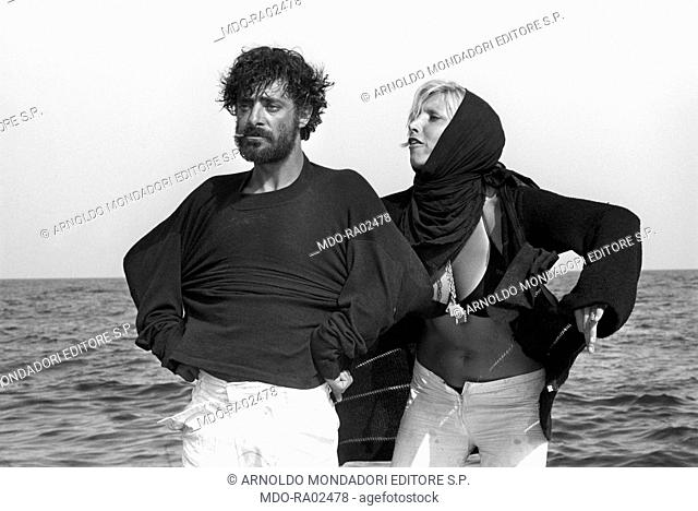 Italian actor, director and scriptwriter Giancarlo Giannini looking resigned while gazing at the horizon and Italian actress Mariangela Melato getting angry in...