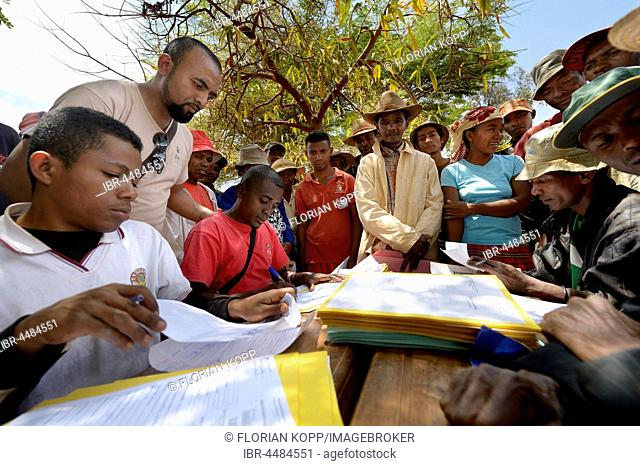 Villagers fill out applications for certification of their land on the village square, Analakely village, Tanambao commune, Tsiroanomandidy district