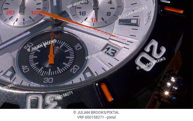 The sweep hand of a chronograph counting seconds