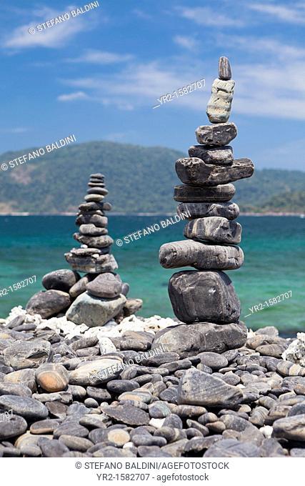 The black pebble stones of Ko Hin Ngam island, Tarutao National Marine Park, Thailand