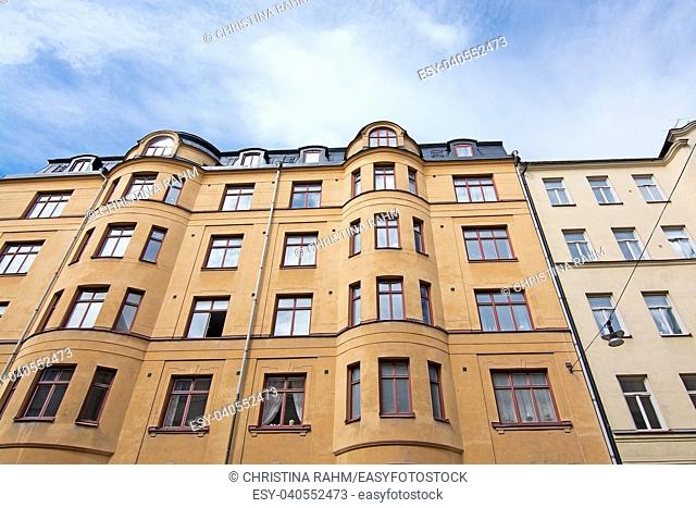 STOCKHOLM, SWEDEN - JULY 11, 2018: Vasastan typical century old buildings in yellow roughcast on July 11, 2018 in Stockholm, Sweden