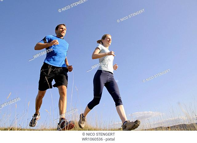 Man and woman jogging together