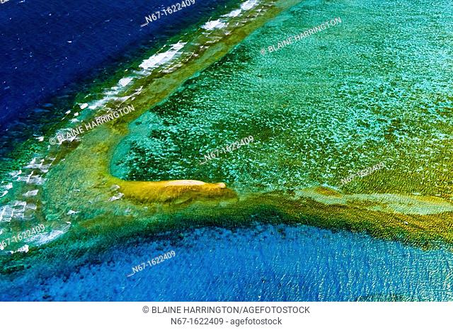 Waves breaking on the New Caledonia Barrier Reef the second longest double-barrier reef in the world, a UNESCO World Heritage Site off Noumea on Grand Terre