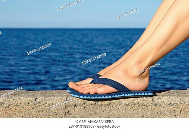 55e7baefe3d54 Girl at beach wearing slippers Stock Photos and Images