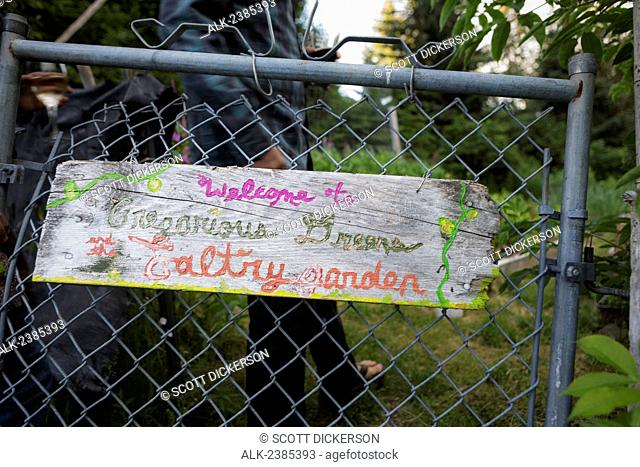 Close up of the sign welcoming visitors to the garden of the Saltry restaurant, Halibut Cove, Southcentral Alaska