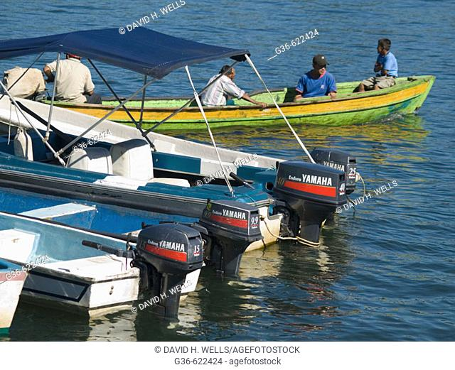 Boats on the river in Rio Dulce, Guatemala