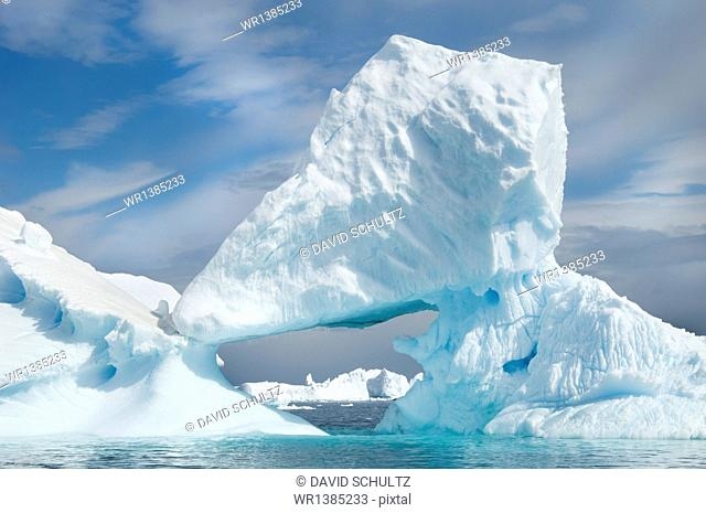 Icebergs floating on the Antarctic southern oceans. Eroded by wind and weather, creating natural ice arches