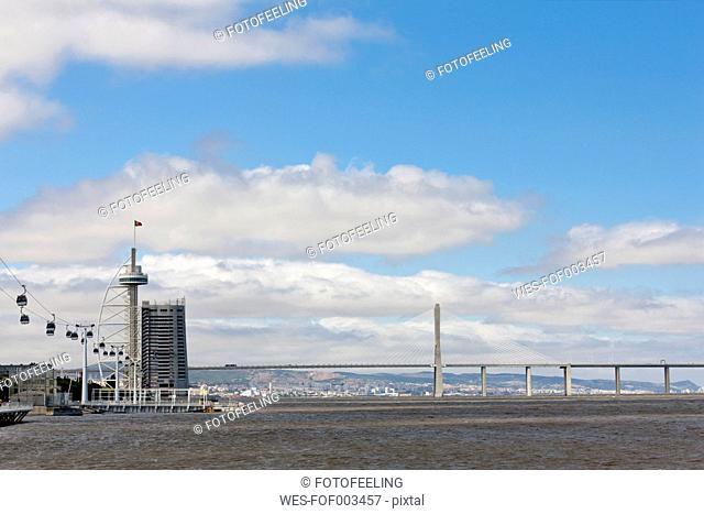 Europe, Portugal, Lisbon, Parque das Nacoes, View of Vasco da Gama tower and Vasco da Gama bridge