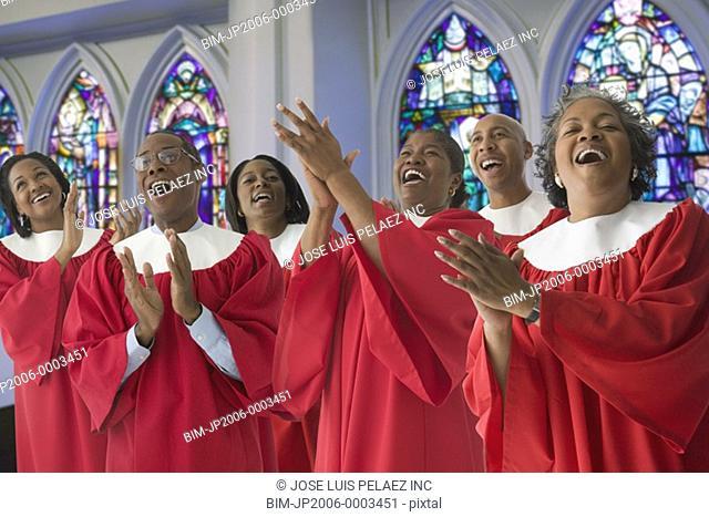 African men and women singing in church choir