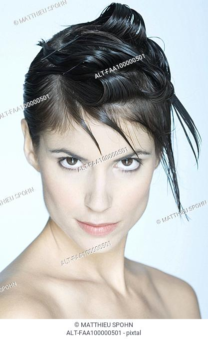 Woman with spiky hairstyle, portrait