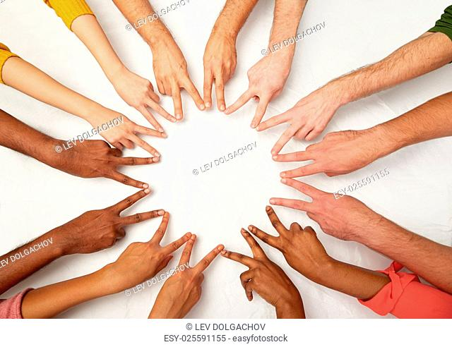 diversity, race, ethnicity, international and people concept - group of hands showing peace hand sign