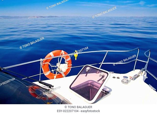 Boat bow open porthole sailing blue calm sea