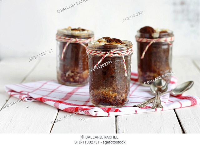 Mini German chocolate cakes with coconut and pecan nuts in jars as gifts