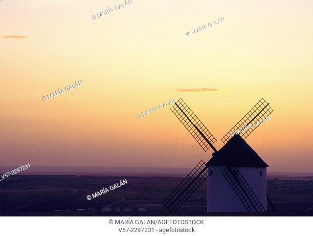 Silhouette of windmill at sunset. Mota del Cuervo, Cuenca province, Castilla La Mancha, Spain