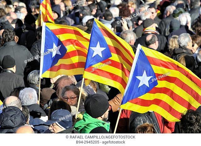 pointed star in a triangle at the hoist. Demonstration on February 03, 2017 in favor of the Independence of Catalonia. Estelades, independentist flags