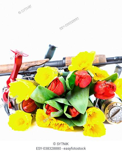 fishing tackles with spring flowers narcissus and tulips on white background for outdoor active business for women present