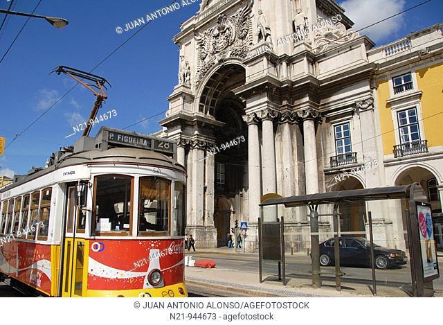 The popular Tramway 28 passing by the Arco do Triunfo (19th century) and official buildings. Praça do Comércio, also known as Terreiro do Paço , Baixa, Lisbon