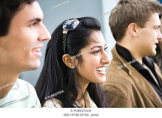 Close-up of happy woman smiling with her friends
