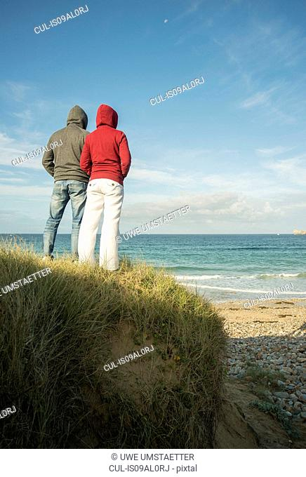 Mature couple gazing at sea view, Camaret-sur-mer, Brittany, France