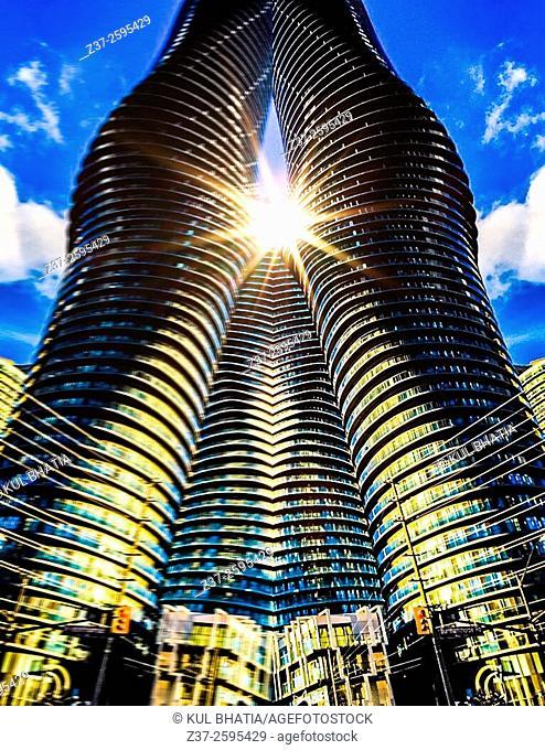 Sun flares through curvy, modern architecture, Ontario, Canada