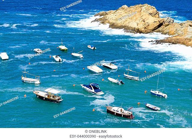 Aerial view of pleasure boats anchored near Shore at Sa Tuna beach, Costa Brava Spain