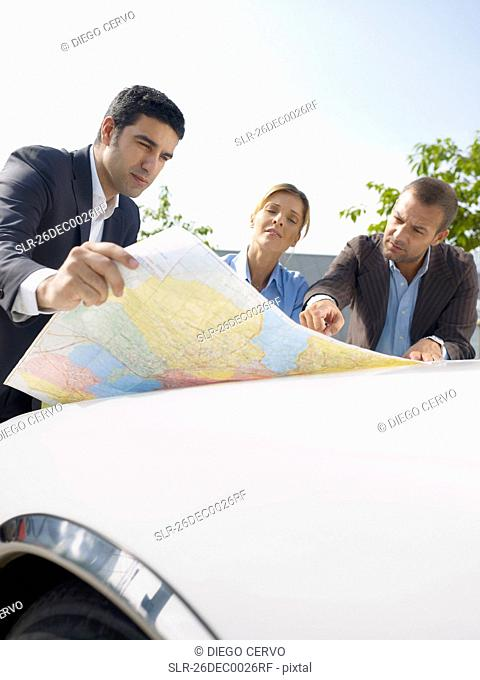 Businesspeople looking at map