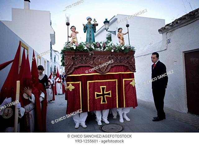 Penitents walk in a street during Easter Holy Week celebrations in Espera village, Cadiz province, Andalusia, Spain