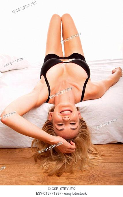 blonde woman on bed