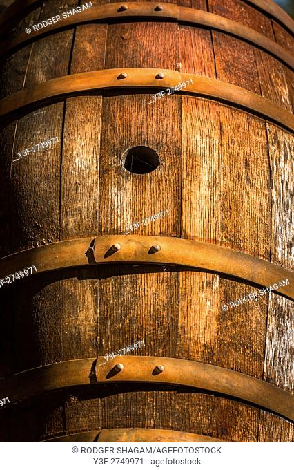 Old wine barrel, dried-out with rusting hoops
