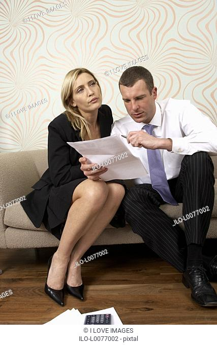 Couple discussing business