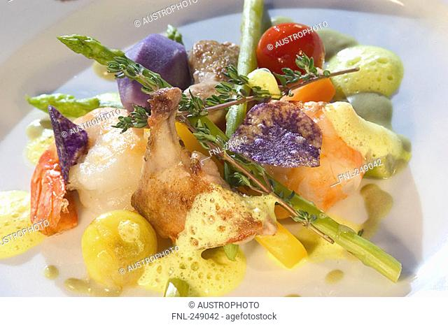 Close-up of asparagus and shrimp in sauce