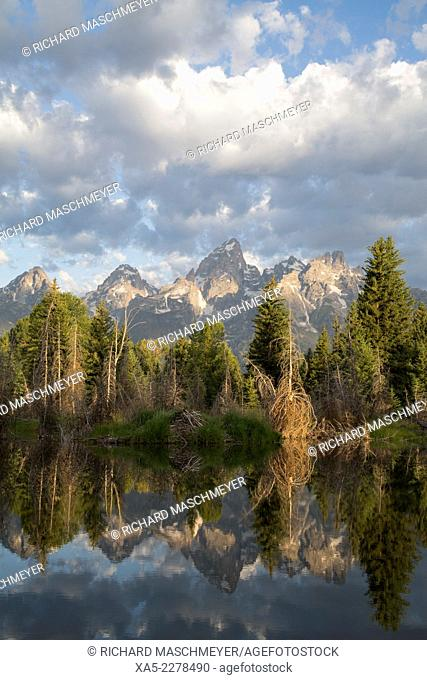 Water reflections of the Teton Range, Beaver House (foreground), taken from the end of Schwabacker Road, Grand Teton National Park, Wyoming, USA